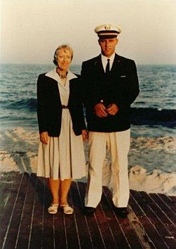 man and woman in uniform