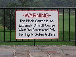 a sign warning that the black course is extremely difficult