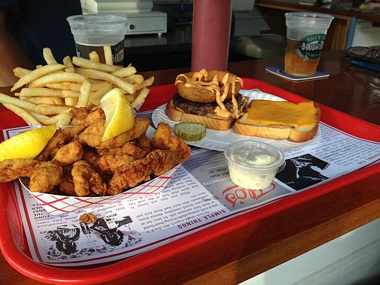 fried clams and a cheeseburger on a lunch tray