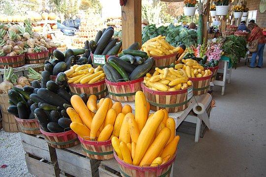vegitables in baskets at an open air market