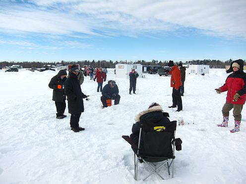 People ice fishing.