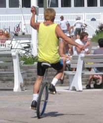 A man riding a unicycle