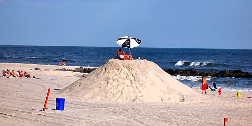 lifeguards on a huge sand pile