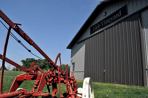 An old plow and modern barn