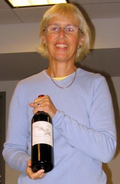 Lousia Hargrave with a bottle of her 1980 Cabernet