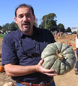 me holding a green pumpkin