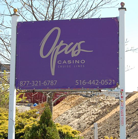 A sign post for Opus casino cruise lines.