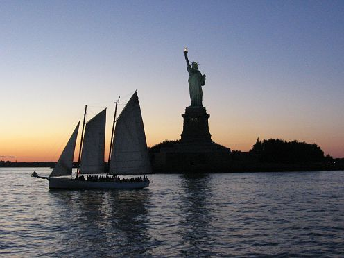 Sailboat and the Statue of Liberty