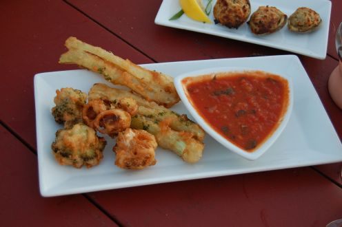 fried vegetables and baked clams